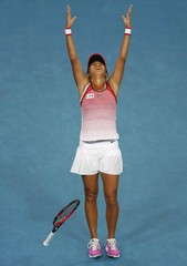 China's Zhang celebrates after winning her third round match against Lepchenko of the U.S. at the Australian Open tennis tournament at Melbourne Park