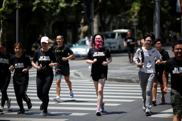 Participants take part in a Pride Run, an event of the ShanghaiPRIDE LGBT celebration in Shanghai,