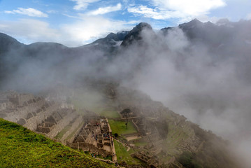 Morning mist rising above Macchu Pichu Valley, Peru