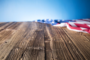 Independence Day concept. American flag on the wooden rustic table.