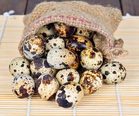 Quail eggs on wood
