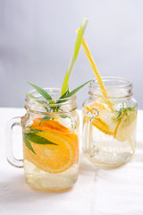 Water with orange, lemon and mint leaves