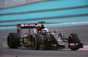 Lotus Formula One driver Romain Grosjean of France drives during the third free practice session of Abu Dhabi F1 Grand Prix at the Yas Marina circuit in Abu Dhabi