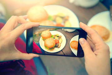 Food photography of hamburgers with vegetables. Top view smartphone photo for social networks