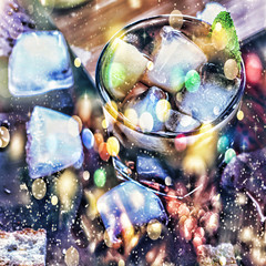 Rum. Falling snow, gold snowflakes. New Year , Christmas . Toned picture, alcohol, Rum, ice, coctail, Top view, closeup