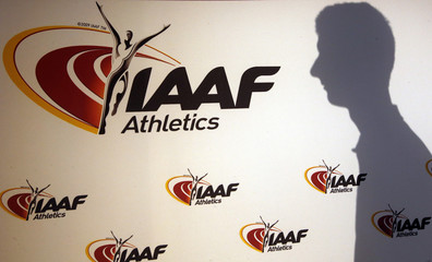 A man casts his shadow following a press conference by Sebastian Coe, IAAF's President, as part of the 203nd International Association of Athletics Federations (IAAF) council meeting  in Monaco