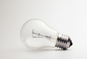 Transparent light bulb on a white background.