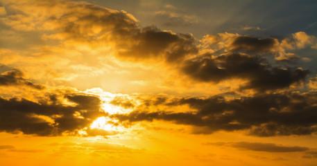 Fotobehang - Dark clouds and bright sun at sunset