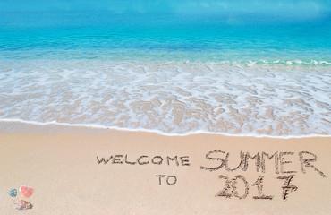 welcome to summer 2017 written on a tropical beach
