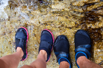 Young couple in water shoe