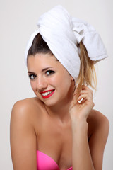 Beautiful young woman with bath towel