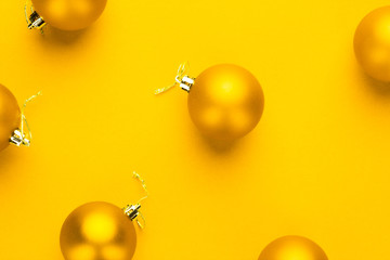 Christmas tree decoration balls on yellow background