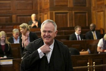 Defence lawyer Barry Roux gestures before an appeal by state prosecutors against Pistorius's conviction last year at the Supreme Court of Appeal (SCA) in Bloemfontein