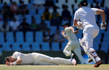 Cricket - New Zealand v South Africa - second cricket test match - Centurion Park , Centurion , South Africa - 28/8/2016 New Zealand's Tim Southee lies on the crease after he fell while attempting to field a ball.