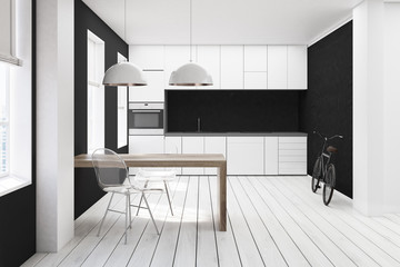 White and black kitchen, transparent chair