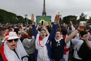 England fans with beer reacts in the fan zone to watch a EURO 2016 match in Paris