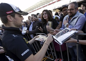 Lotus F1 Formula One driver Roman Grosjean of France autographs posters of him before the Mexican F1 Grand Prix at Autodromo Hermanos Rodriguez in Mexico City