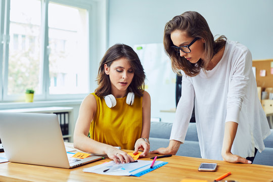 Two women working together at office