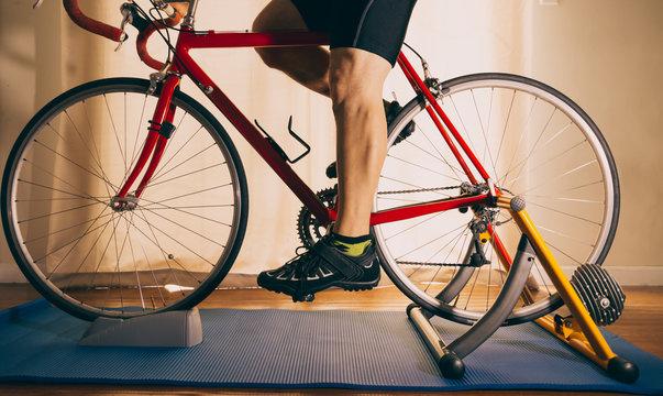 Man riding bike on trainer indoors