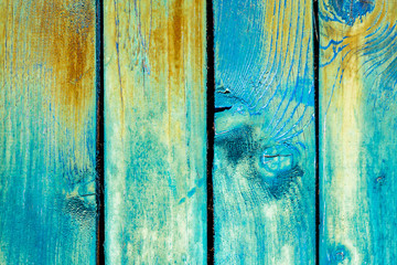 Old painted wood background. Wood material background for Vintage wallpaper. Blue and yellow