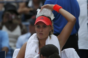 Mladenovic of France places a bag of ice on her head to cool off during her quarterfinals match against Vinci of Italy at the U.S. Open Championships tennis tournament in New York