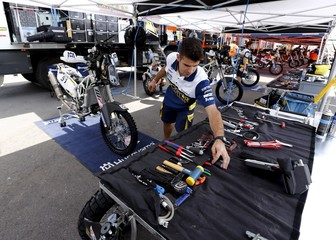 A mechanic of the Husqvarna Racing Team works in the team's box ahead of the Dakar Rally 2016 in Buenos Aires