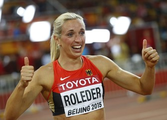 Roleder of Germany celebrates winning silver in women's 100 metres hurdles final at 15th IAAF World Championships in Beijing