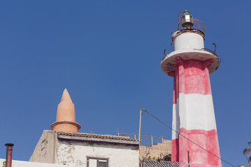 Lighthouse in Jaffo over sky background with copy space
