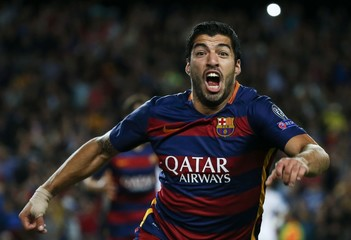 Barcelona's Luis Suarez celebrates after scoring a goal against Bayer Leverkusen during their Champions League group E soccer match at Camp Nou stadium in Barcelona