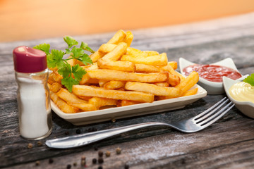 Plate with french fries and big fork