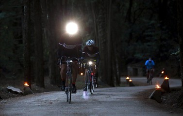 """Cyclist rides a vintage bicycle on gravel roads in the early morning during the Strade Bianche section of the """"Eroica"""" cycling race for old bikes in Gaiole in Chianti"""