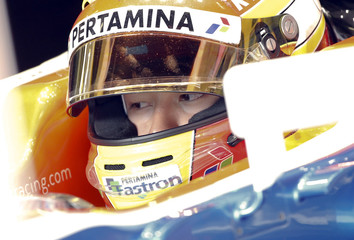 Manor Racing Formula One driver Haryanto of Indonesia sits in his car during the third testing session ahead the upcoming season at the Circuit Barcelona-Catalunya in Montmelo