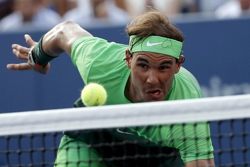 Nadal of Spain lunges towards the net to hit a return to Schwartzman of Argentina during their match at the U.S. Open Championships tennis tournament in New York