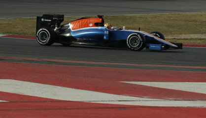Manor Racing Formula One driver Haryanto of Indonesia speeds his car during the fourth testing session ahead the upcoming season at the Circuit Barcelona-Catalunya in Montmelo