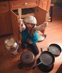 Creative Child Playing Music with Pots and Pans