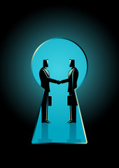 Businessmen shaking hands seen through a keyhole