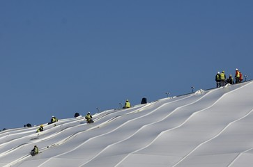 "Workers are seen on the roof of the ""Grand Stade"", the new Olympique Lyon's stadium in Decines near Lyon"