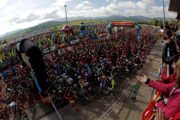 Mountain bikers and runners wait for the start of the XIX 101km international competition in Ronda