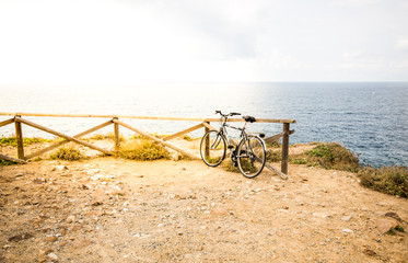 Blurred image. Bicycle parked on the beach with sunny day in tone vintage style.