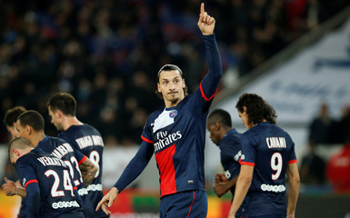 Paris St Germain's Zlatan Ibrahimovic celebrates with his team mates after scoring against FC Nantes during their French Ligue 1 soccer match at the Parc des Princes Stadium in Paris