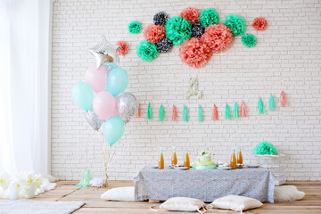 Loft with a covered table for celebrating children's birthday