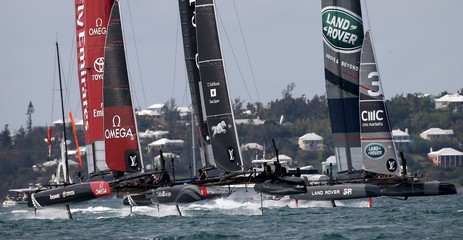 AC45F racing sailboats Emirates team New Zealand, SoftBank Team Japan and Land Rover BAR race downwind during America's Cup World Series sailing competition in Hamilton