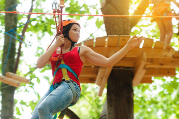 Woman on the roping park