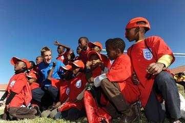 England's Michael Dawson and Matthew Upson Visit Tlhabane Township