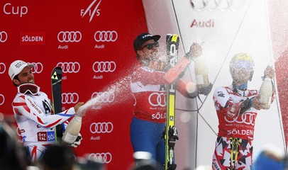 Fanara of France, Ligety of the U.S. and Hirscher of Austria spray sparkling wine after the alpine World Cup men's giant slalom race on the Rettenbach glacier in the Tyrolean ski resort of Soelden