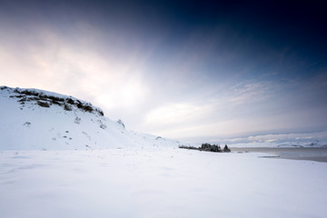 Horizontal, panoramic snow covered landscape scenic at day, Iceland, Europe.
