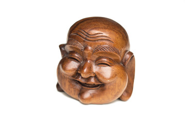 Wooden happy Buddha head statue. Souvenir from Indonesia, Southeast Asia. White background.