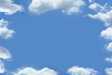 Clouds frame blue sky background with copy space.