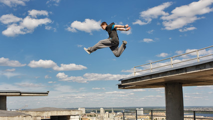 Man jumps from roof to roof. Parkour