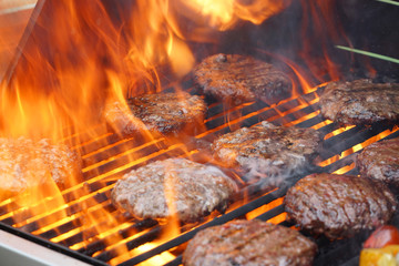 Poster Grill / Barbecue barbecue grill cooking burger steak on the fire